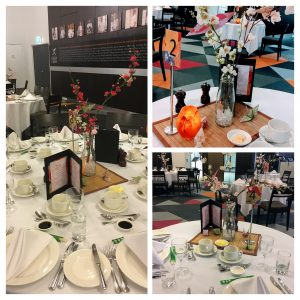 The Event Styling was a Japanese 'Matsuri' theme. This means festival in Japanese. The origami cranes and puff balls, parasol table numbers and patterned menus were used to achieve this look without being in the way of the guests while they dined.