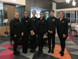 L-R: Samantha Redman (Beverage Co-ordinator), Jennifer Radu (Event Administrator), Sarah Bast (Front of House Co-ordinator), Caitlin Williams (Event Stylist), Akiko Hayashi (Protocol Co-ordinator) and Silvana Madia (Teacher)